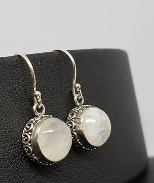 Circular silver moonstone earrings with filigree detailing
